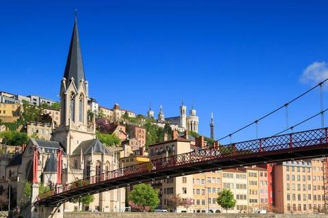 A photo of Lyon, France showing buildings and a bridge